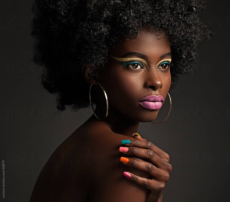 African Woman with Colourful Make-Up by Lumina for Stocksy United