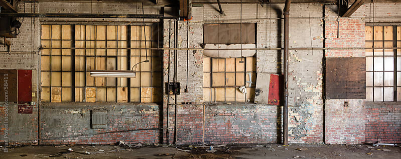 An old, run down warehouse  wall by Brian Powell for Stocksy United