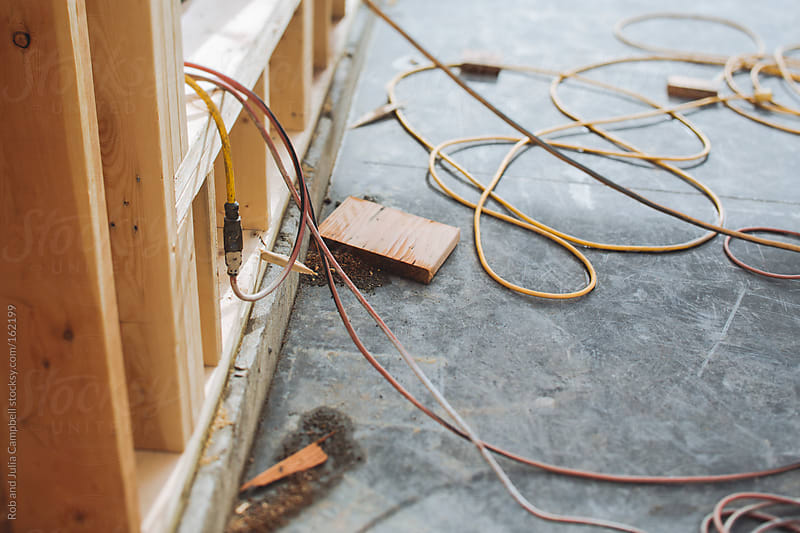 Detail of electrical chords at construction site by Rob and Julia Campbell for Stocksy United