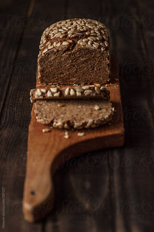Fresh Brown Bread on a Wooden Cutting Board by Mosuno for Stocksy United