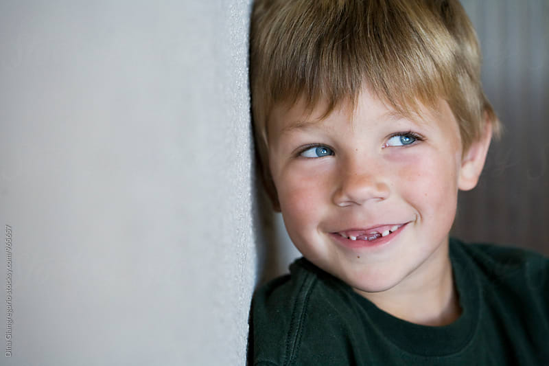 Little Boy Smiling With Missing Front Teeth by Dina Giangregorio for Stocksy United