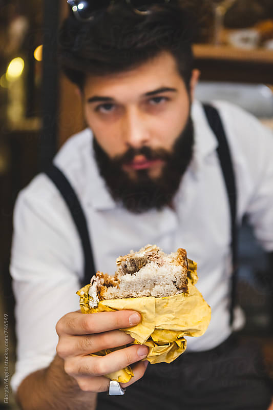 Young Bearded Man Offering a Rustic Sandwich Panino in Italy by Giorgio Magini for Stocksy United