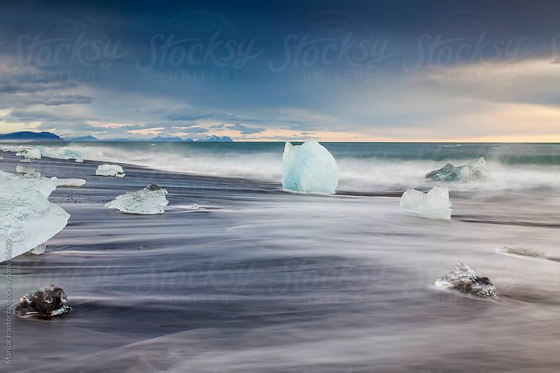 Sunrise on the beach Jokulsarlon in Iceland by Marilar Irastorza for Stocksy United