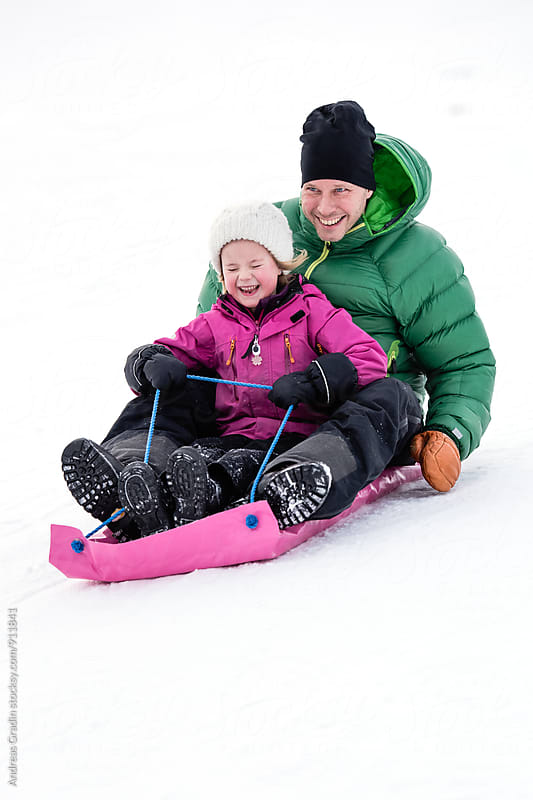 father and daughter winter fun by Andreas Gradin for Stocksy United