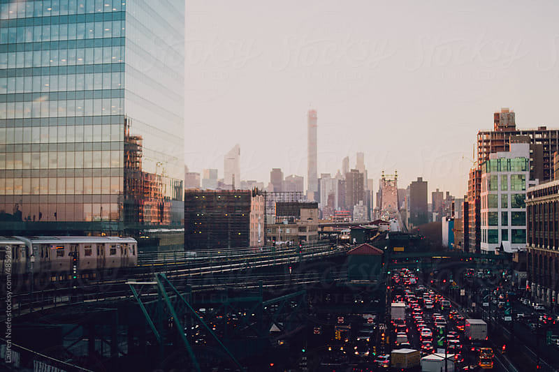 Subway station between Manhattan and Queens, with NYC skyline by Lauren Naefe for Stocksy United
