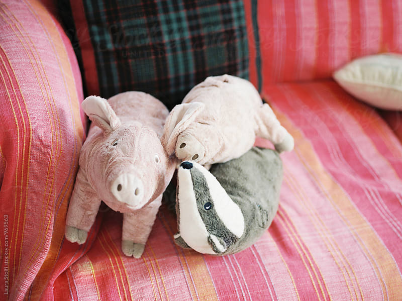 Stuffed animal toys on sofa by Laura Stolfi for Stocksy United