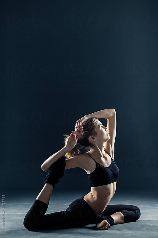 Pigeon Yoga Position by Lumina for Stocksy United
