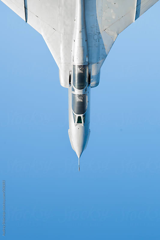 Fighter jet with blue sky in background. by Audrey Shtecinjo for Stocksy United