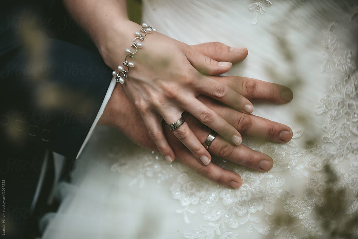 Detail Of Caressingly Bridal Couple Hands With Wedding Rings