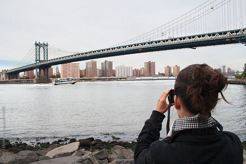 Young woman photographing Manhattan by ACALU Studio for Stocksy United