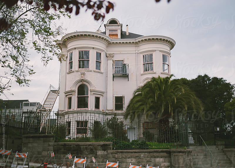 Old boarded up victorian house in San Francisco. by Lucas Saugen for Stocksy United