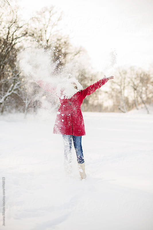 Little girl playing in the snow by Jovana Rikalo for Stocksy United