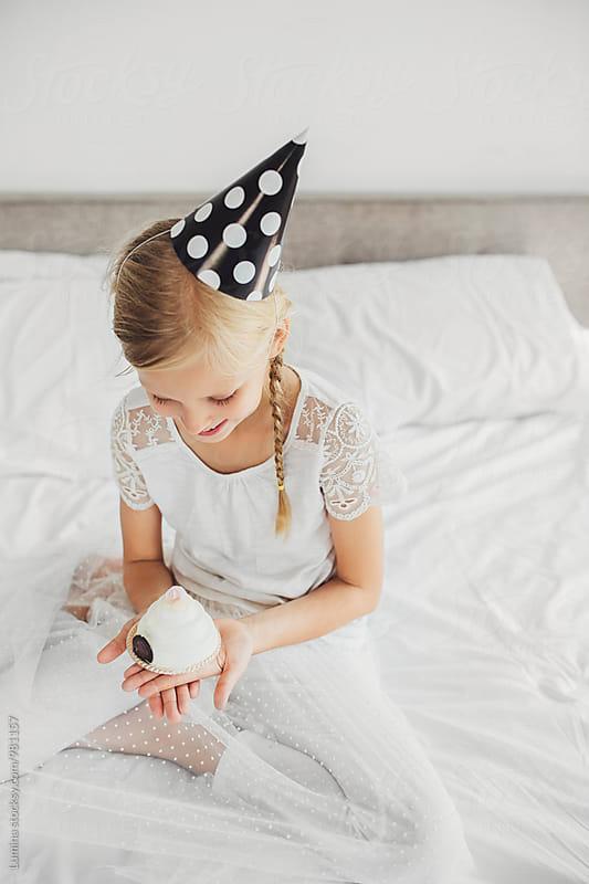 Girl Holding Cake by Lumina for Stocksy United