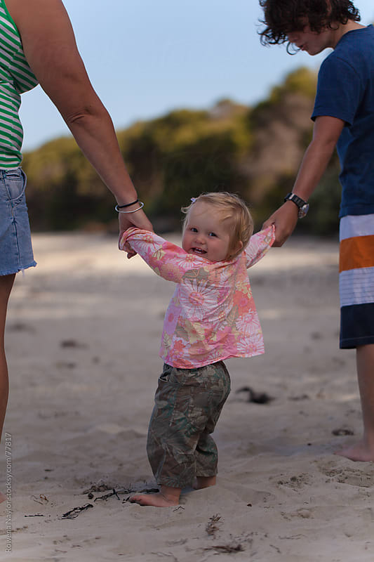 Happy Toddler Learnning to Walk at the Beach in Summer by Rowena Naylor for Stocksy United