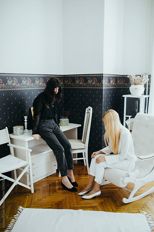 Two fashionable young women by Jovana Rikalo for Stocksy United
