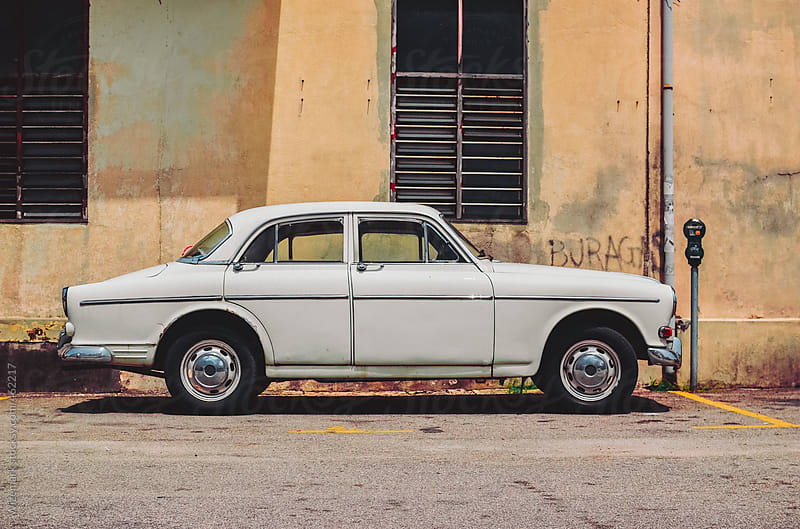 Classic vintage white retro car parked on the street by Wizemark for Stocksy United