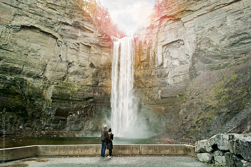 couple in front of Taughannock falls by Tod Kapke for Stocksy United