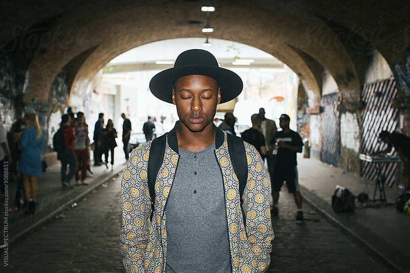 London Street Style - Snapshot of Cool Young Black Man With Eyes Closed at Small Tunnel Street Party by VISUALSPECTRUM for Stocksy United