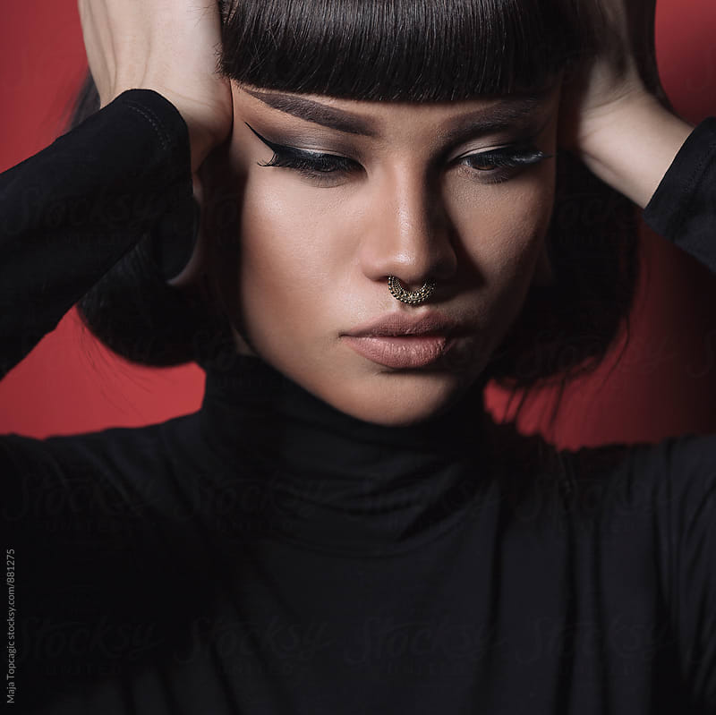 Beautiful woman in studio by Maja Topcagic for Stocksy United