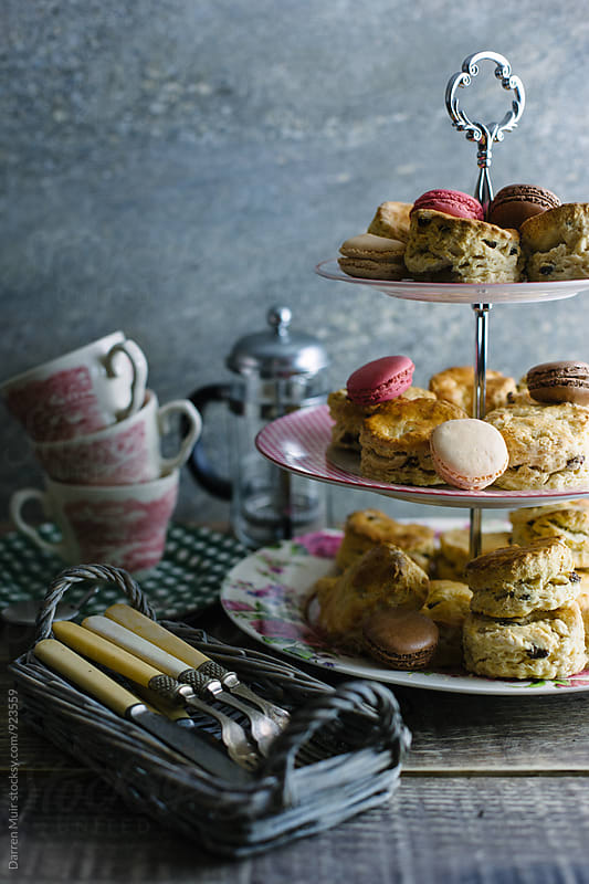 Scones and macarons on a cake stand. by Darren Muir for Stocksy United