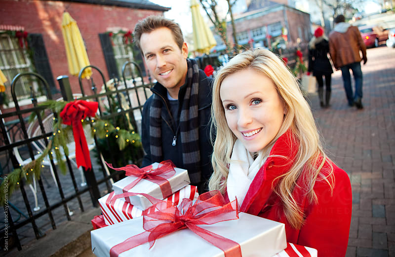 Christmas: Couple Walking with Christmas Gifts by Sean Locke for Stocksy United