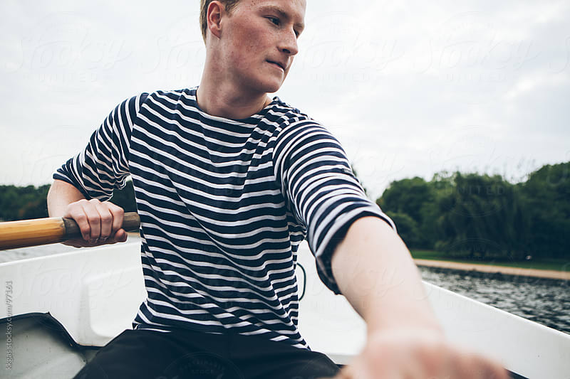 Young man rowing by kkgas for Stocksy United