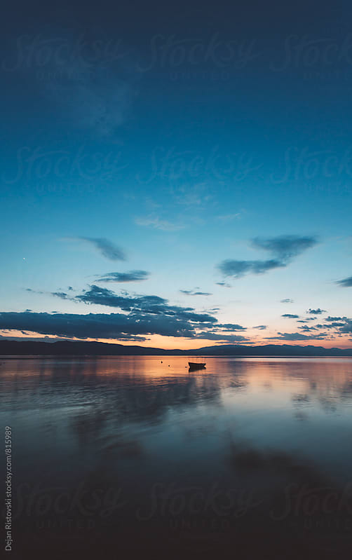 Dawn over a beautiful calm lake  by Dejan Ristovski for Stocksy United