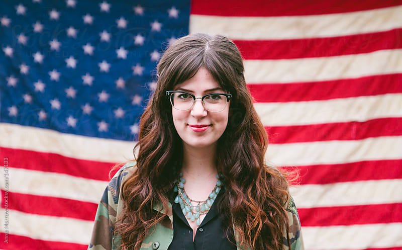 Girl in front of American Flag by Jesse Morrow for Stocksy United