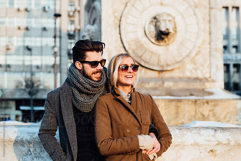 Pretty Couple Enjoying on a Sunny Winter Day by Nemanja Glumac for Stocksy United