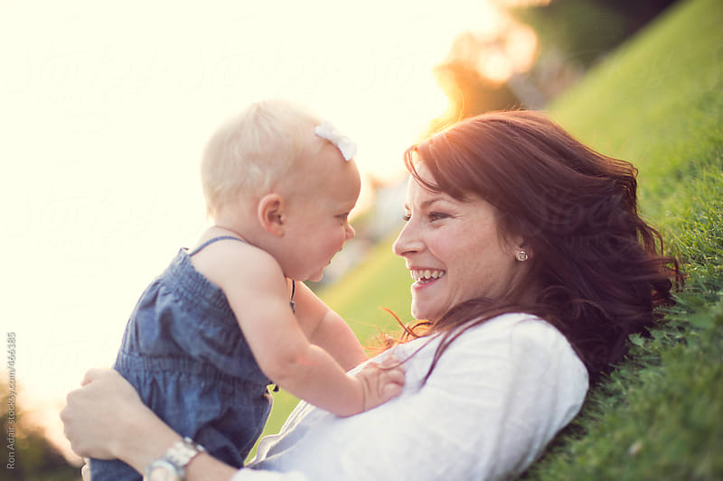 Mother & Daughter Enjoying Nature in Summertime by Ron Adair for Stocksy United