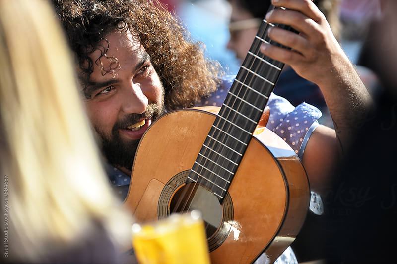 Gypsies playing guitar and singing flamenco in Granada by Bisual Studio for Stocksy United