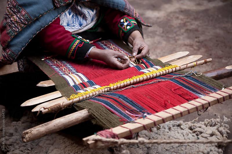 Peru: woman weaving intricate llama wool garments using a traditional hand loom by Ben Ryan for Stocksy United