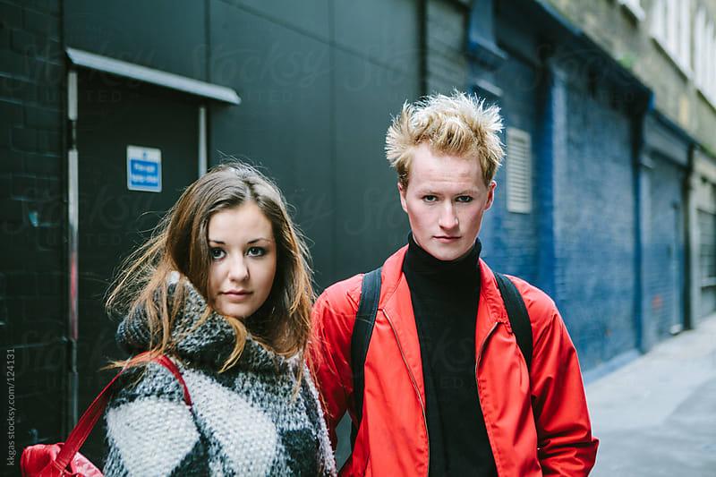 Two friends in a narrow street in London. by kkgas for Stocksy United
