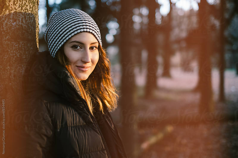 Portrait of Beautiful Woman In Winter Clothing With Light Leaks by Nemanja Glumac for Stocksy United