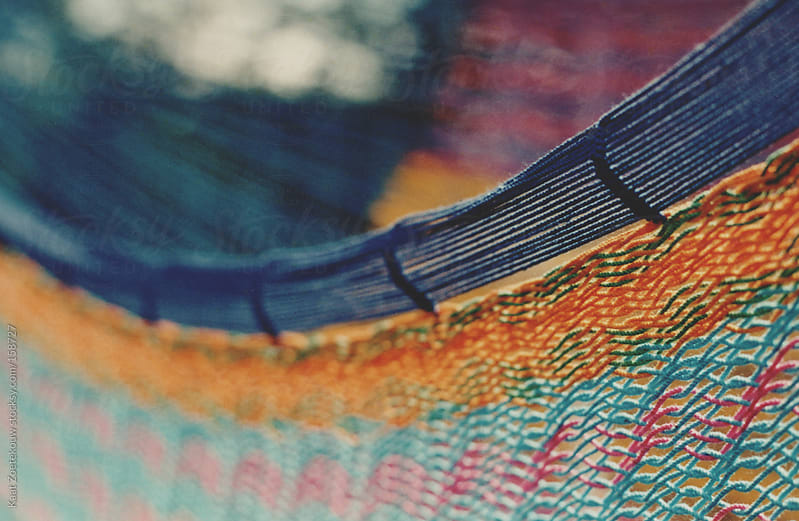Film photo close-up of a colorful woven hammock. by Kaat Zoetekouw for Stocksy United