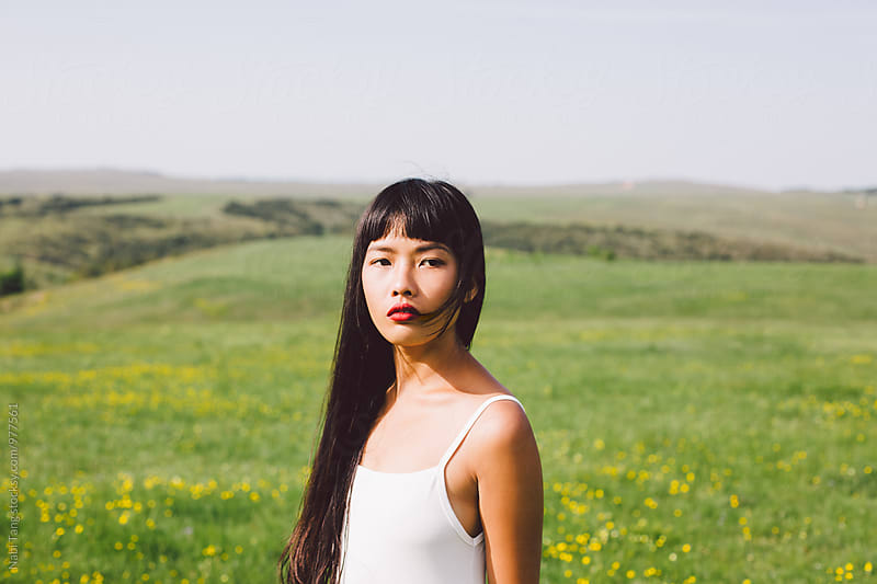 Beautiful Asian young woman enjoying summertime in the nature by Nabi Tang for Stocksy United