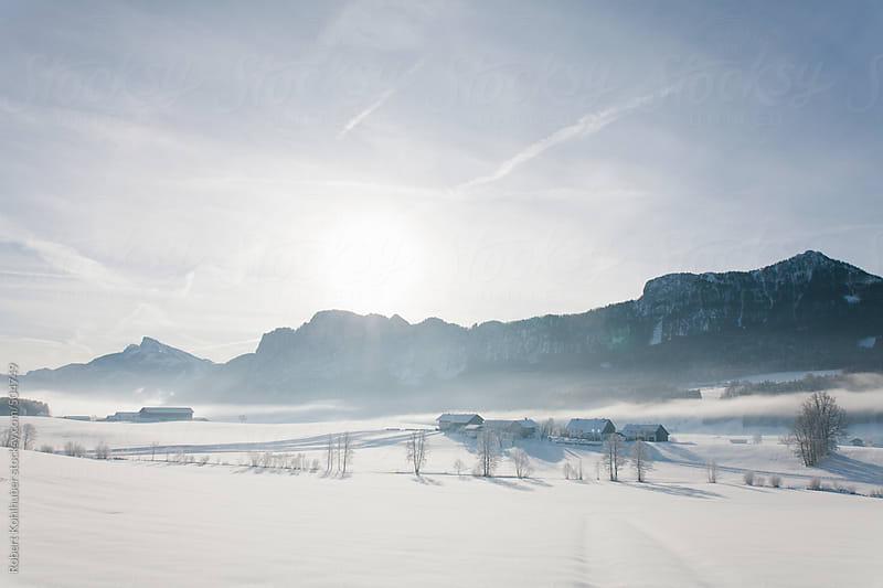 Houses in winter landscape by Robert Kohlhuber for Stocksy United