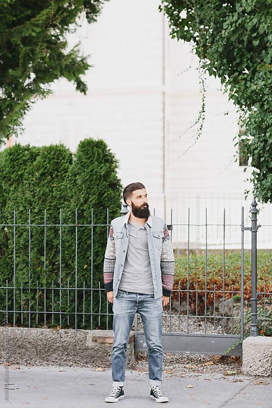 Stylish men walking down the street by Amir Kaljikovic for Stocksy United