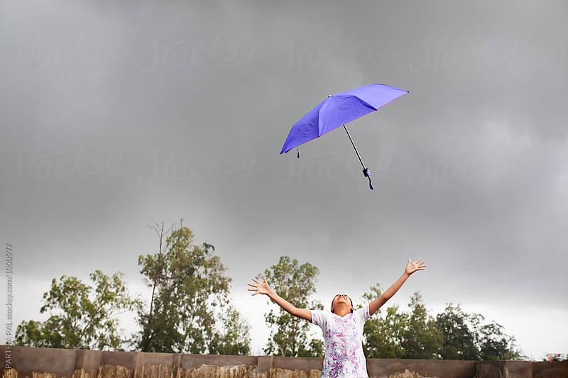 Monsoon season with umbrella in air