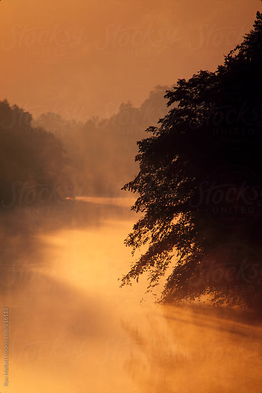 Summer sunrise on Tar River in North Carolina. by Ron Mellott for Stocksy United