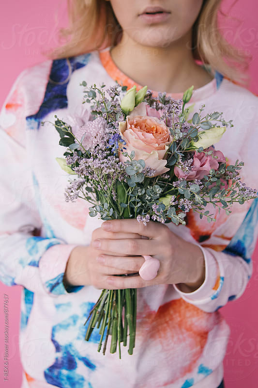 Woman holding wildflower bouquet by Danil Nevsky for Stocksy United