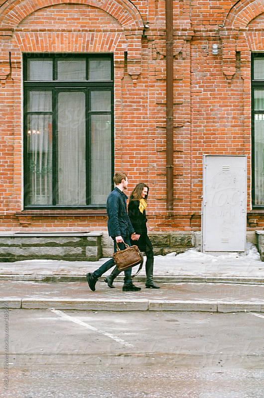 A couple on a sidewalk by T-REX & Flower for Stocksy United