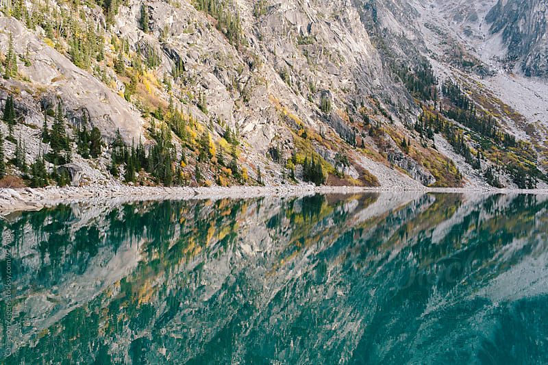 reflections on alpine Lake Colchuck by Cameron Zegers for Stocksy United