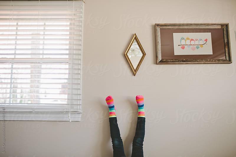 feet on a wall by Erin Drago for Stocksy United