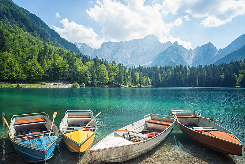 Wooden boats in a lake - European Alps by Simone Becchetti for Stocksy United