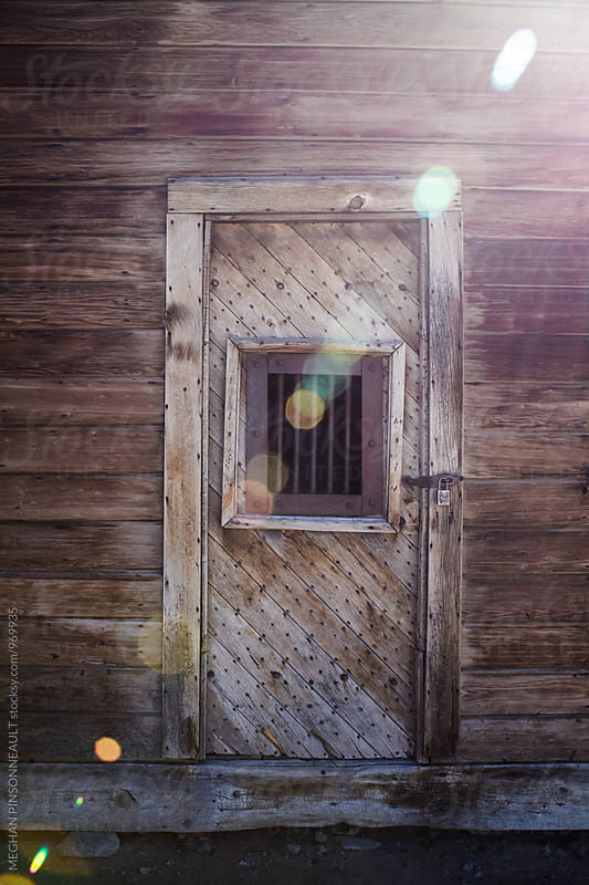 Door to Old Jail in Creepy Ghost Town  by MEGHAN PINSONNEAULT for Stocksy United