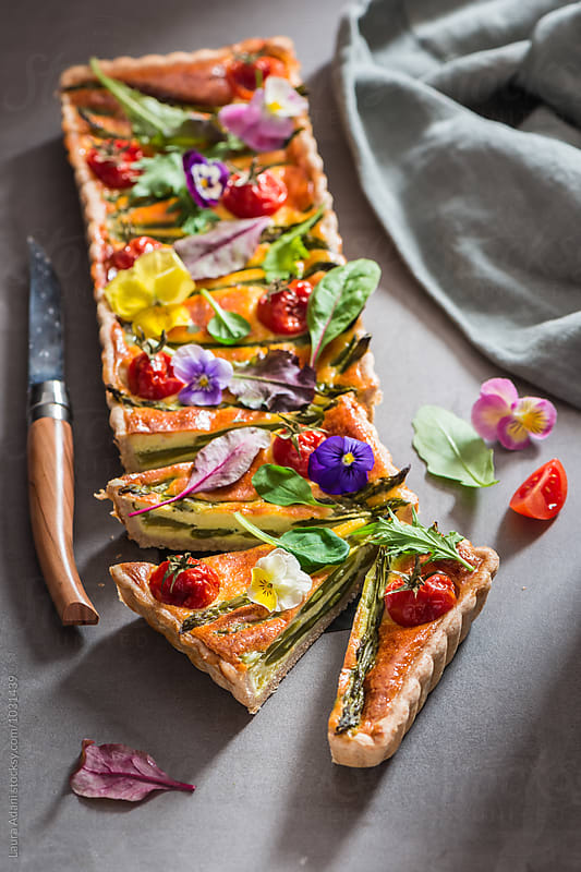 Quiche with asparagus and cherry tomatoes by Laura Adani for Stocksy United