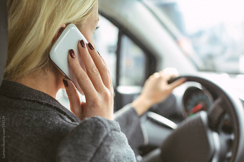 Woman Telephoning in the Car by Lumina for Stocksy United