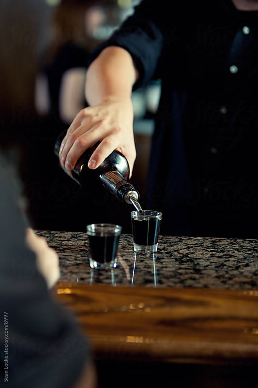 Bar: Pouring a Shot of Alcohol by Sean Locke for Stocksy United