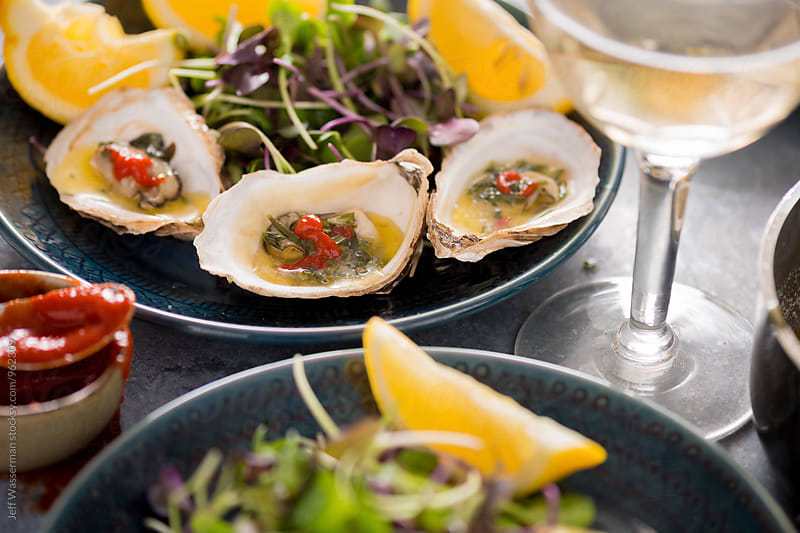 Grilled Oysters with Herb Butter Sauce by Studio Six for Stocksy United